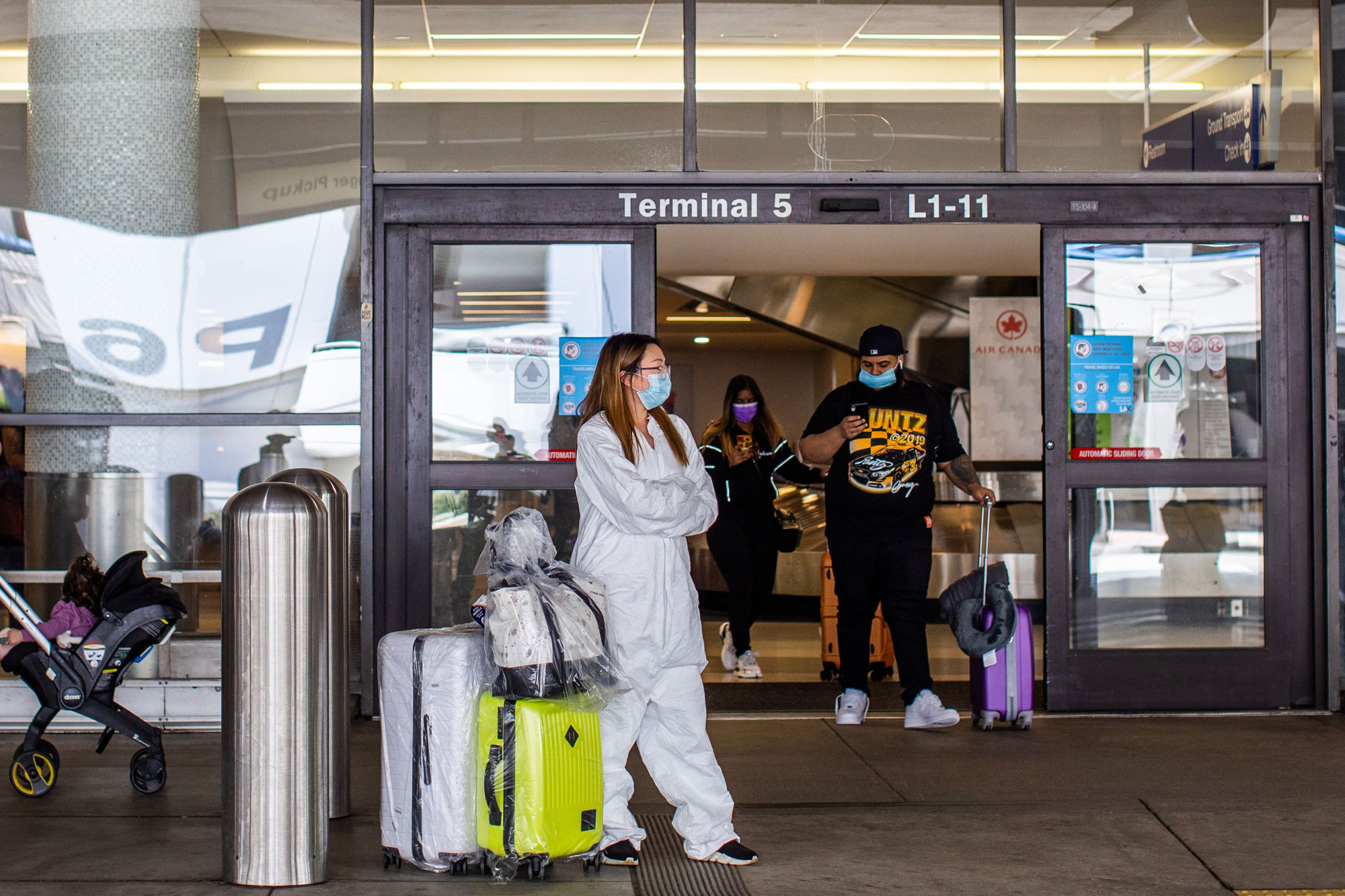 A woman waits for a ride at LAX Airport at the start of the Memorial Day holiday weekend inLos Angeles on May 22.