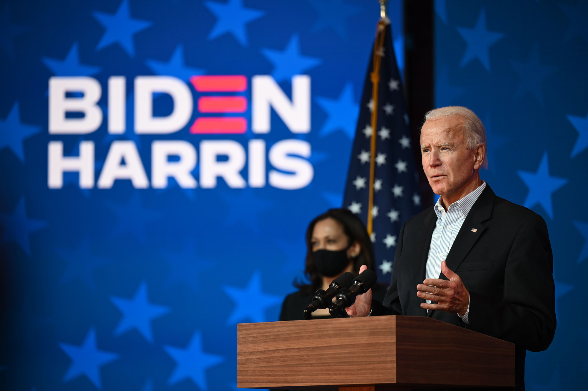 Democratic Presidential candidate Joe Biden speaks as Vice-Presidential candidate Kamala Harris looks on at the Queen venue in Wilmington, Delaware, on November 5.