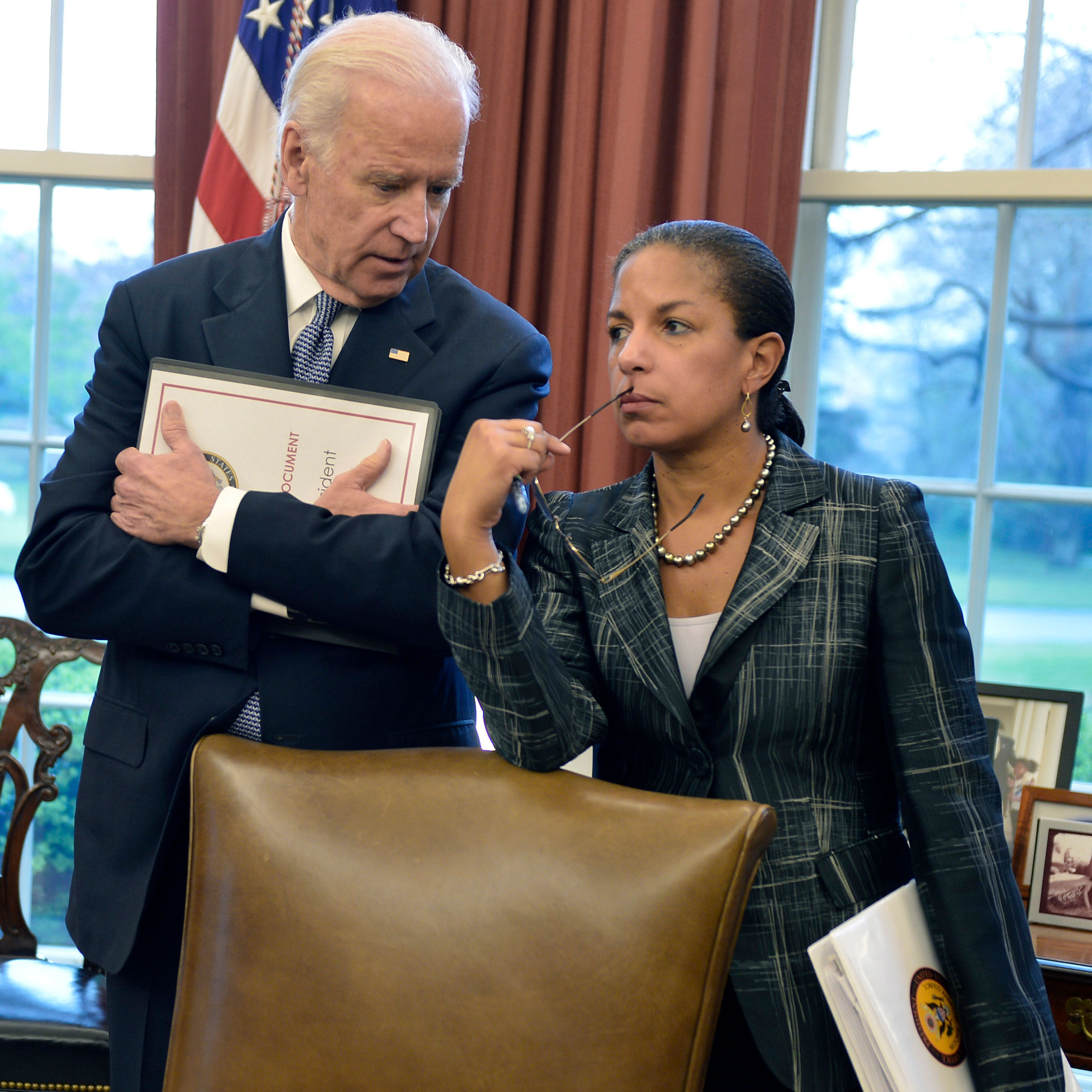 Then-Vice President Joe Biden and then-National Security Advisor Susan Rice speak together during a press briefing in the Oval Office of the White House in 2015.