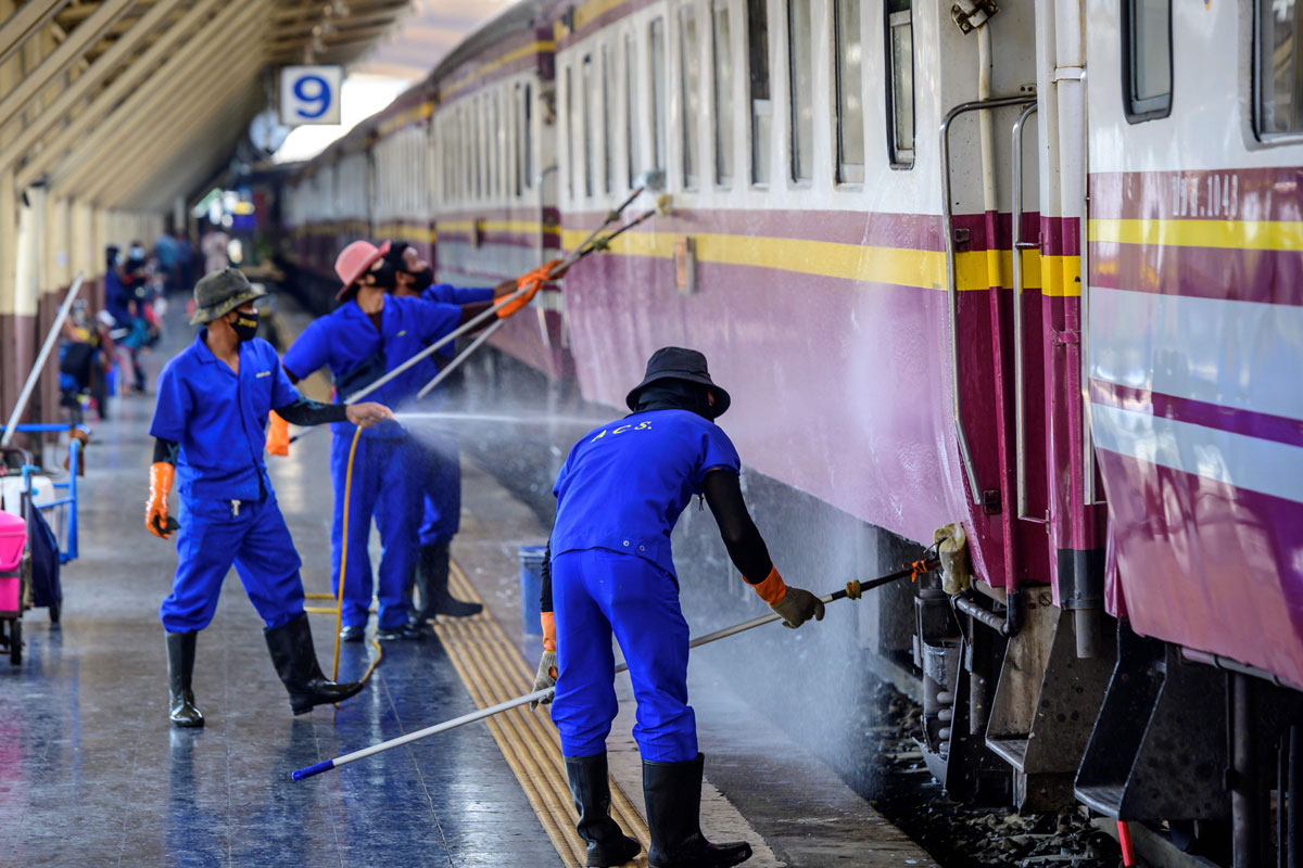 Employees clean and disinfect a train at Hua Lamphong Central Railway Station in Bangkok on January 4.