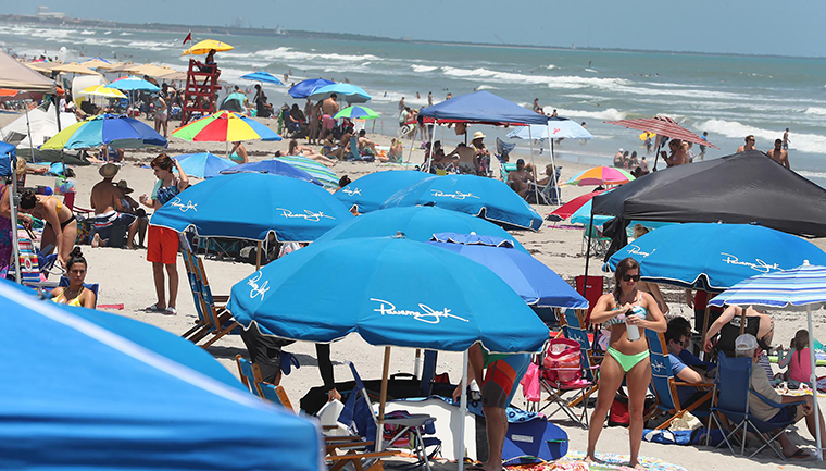Cocoa Beach is seen packed with beachgoers on  Saturday, May 23, Memorial Day weekend, in Cocoa Beach, Florida.  Brevard County is expected to keep beaches open for the upcoming July 4th holiday.