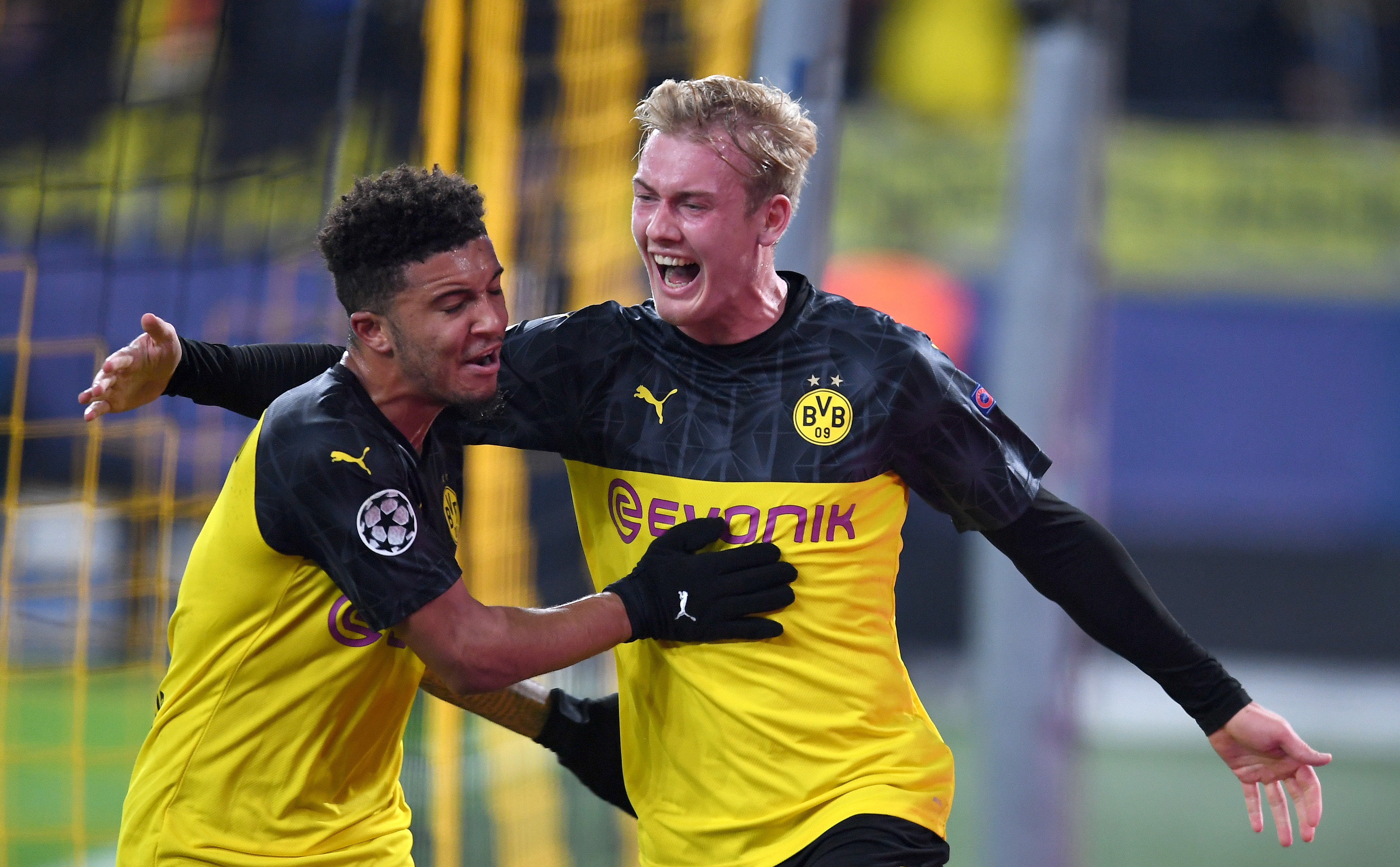 Julian Brandt of Borussia Dortmund celebrates after scoring his team's second goal with teammate Jadon Sancho.