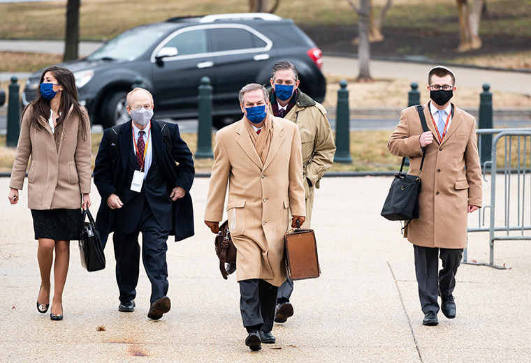Members of former President Donald Trumps defense team, David Schoen, center left, Michael van der Veen, center, and Bruce Castor, center right, arrive at the Capitol before the start of day three of the impeachment trial in the Senate on Thursday, February 11.