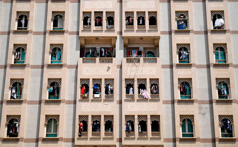 Residents hang their laundry off the railing on their balconies at their apartment building, to disinfect them under sunlight, in the city of Dubai on May 17.