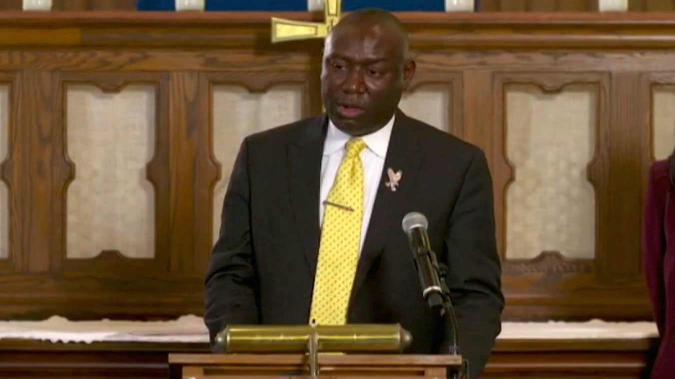 Floyd family attorney Ben Crump holds a news conference on Monday.