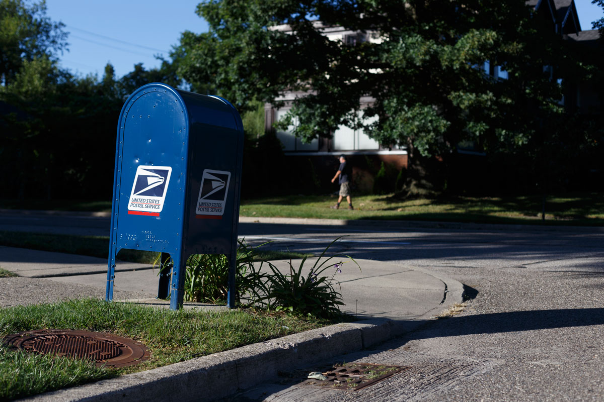 A USPS mail collection box is seen on a corner near Boston Edison and Woodward Village in Detroit, Michigan on September 4.
