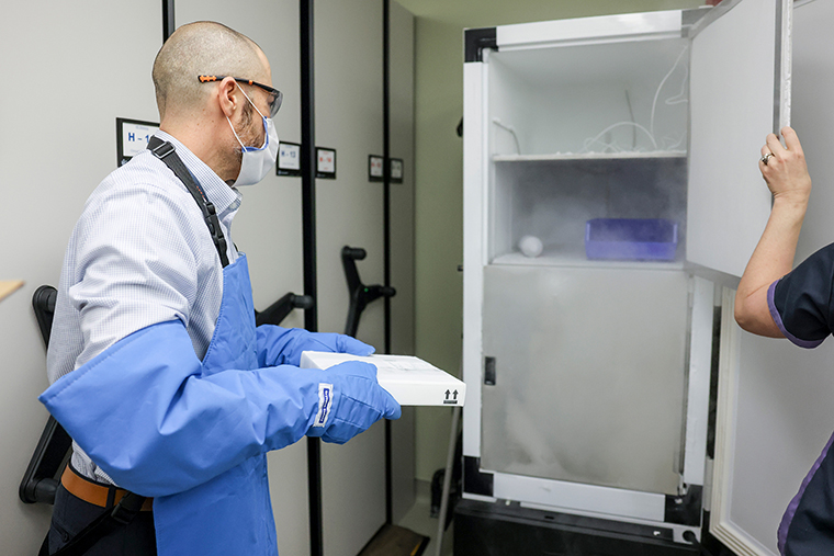 Rocky Mountain Regional VA Medical Center associate chief of pharmacy operations Terrence Wong moves 975 doses of the Pfizer-BioNTech COVID-19 vaccine to a freezer on December 15, 2020 in Aurora, Colorado. The Eastern Colorado VA Health Care System was chosen as one of 37 VA centers around the country to receive the vaccine because of their ability to store the vaccine at extremely cold temperatures and vaccinate a large number of people.
