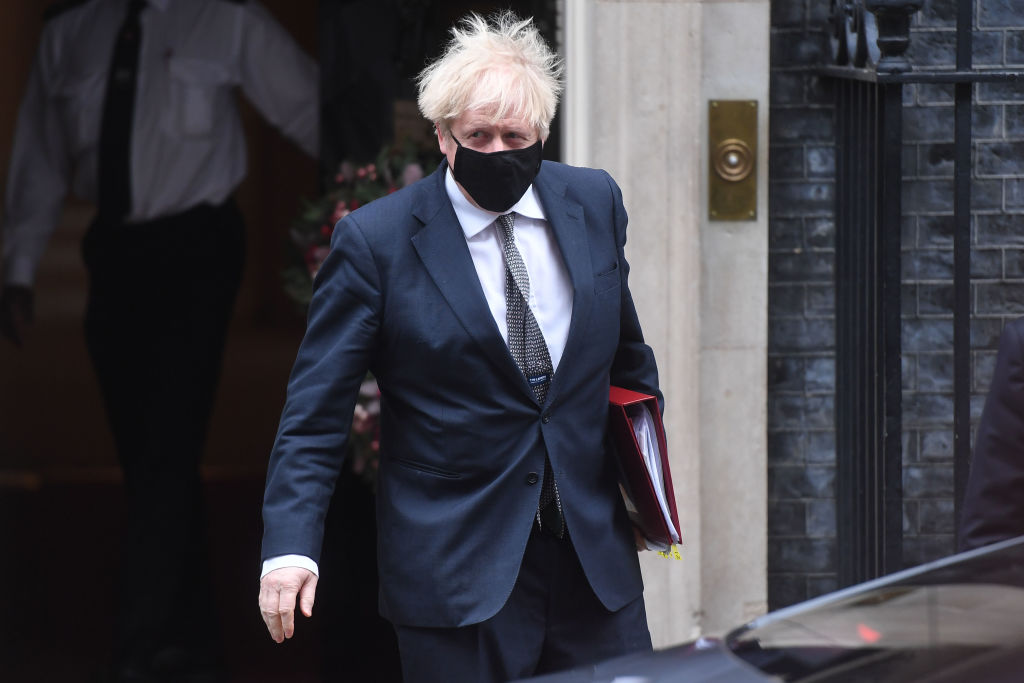Prime Minister Boris Johnson leaves 10 Downing Street to attend the final PMQs Of 2020, on December 16, 2020 in London, England.