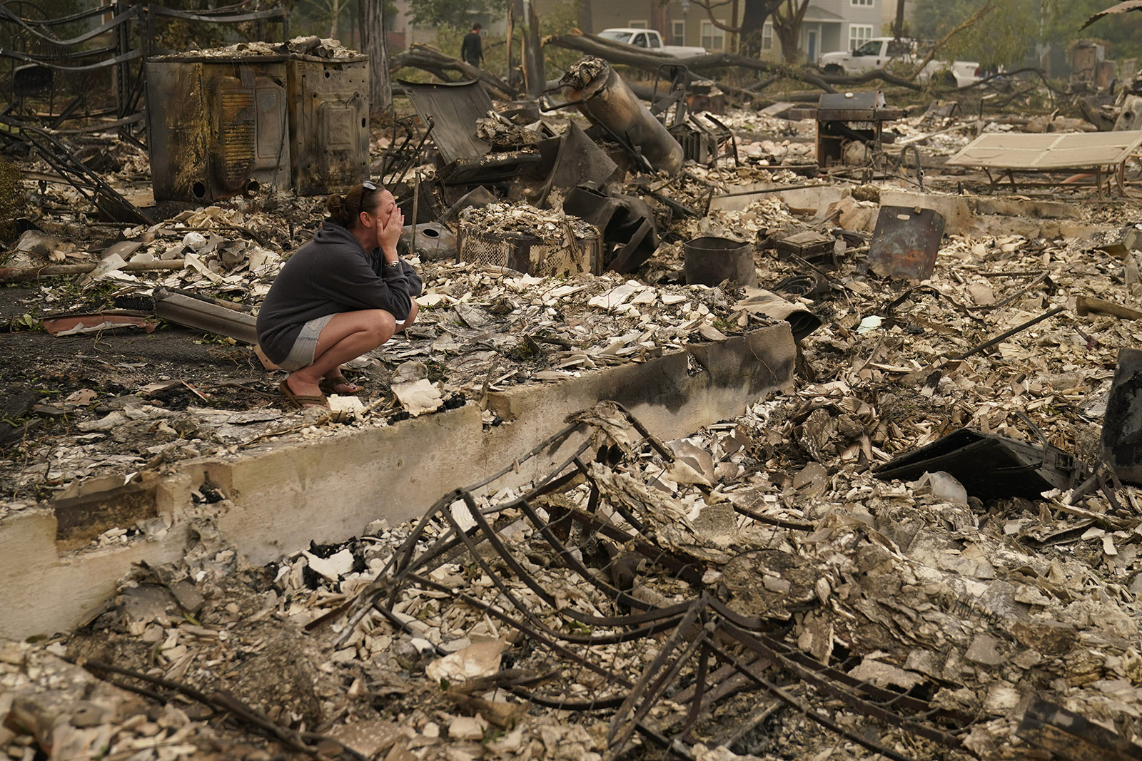 """Desiree Pierce cries as she visits her home destroyed by the Almeda Fire on Friday, September 11, in Talent, Oregon. """"I just needed to see it, to get some closure,"""" said Pierce."""