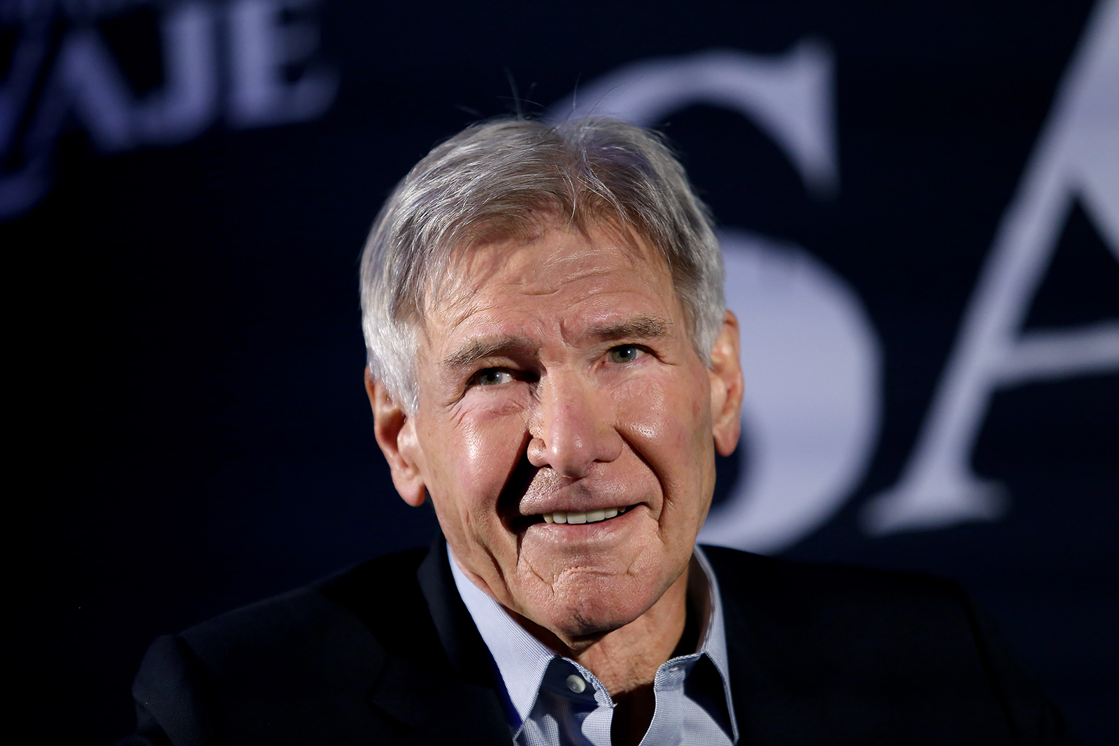 Harrison Ford smiles during a press conference to present the film 'El Llamado Salvaje' on February 5, in Mexico City.