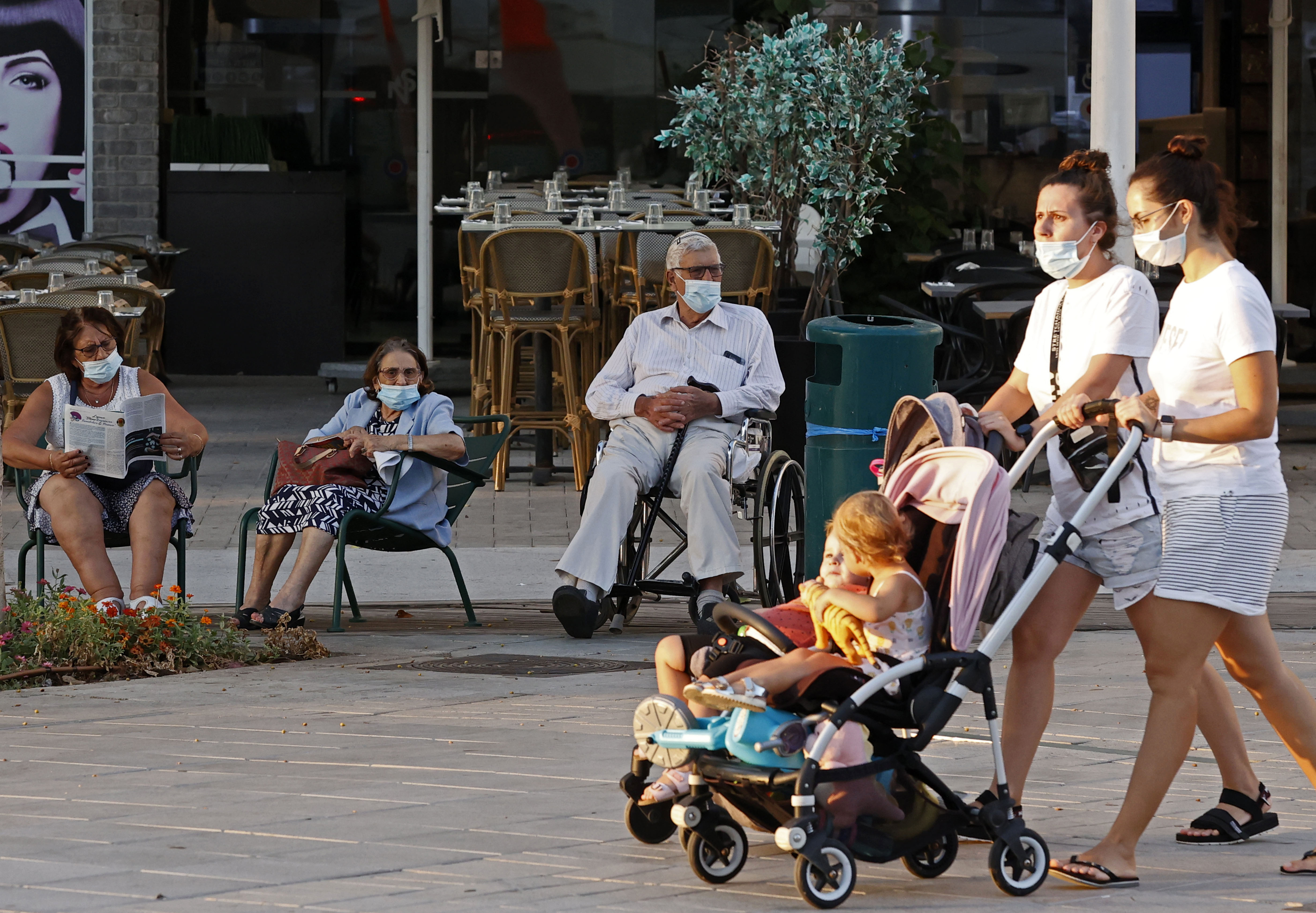 People are seen in the Israeli coastal city of Netanya on September 14.