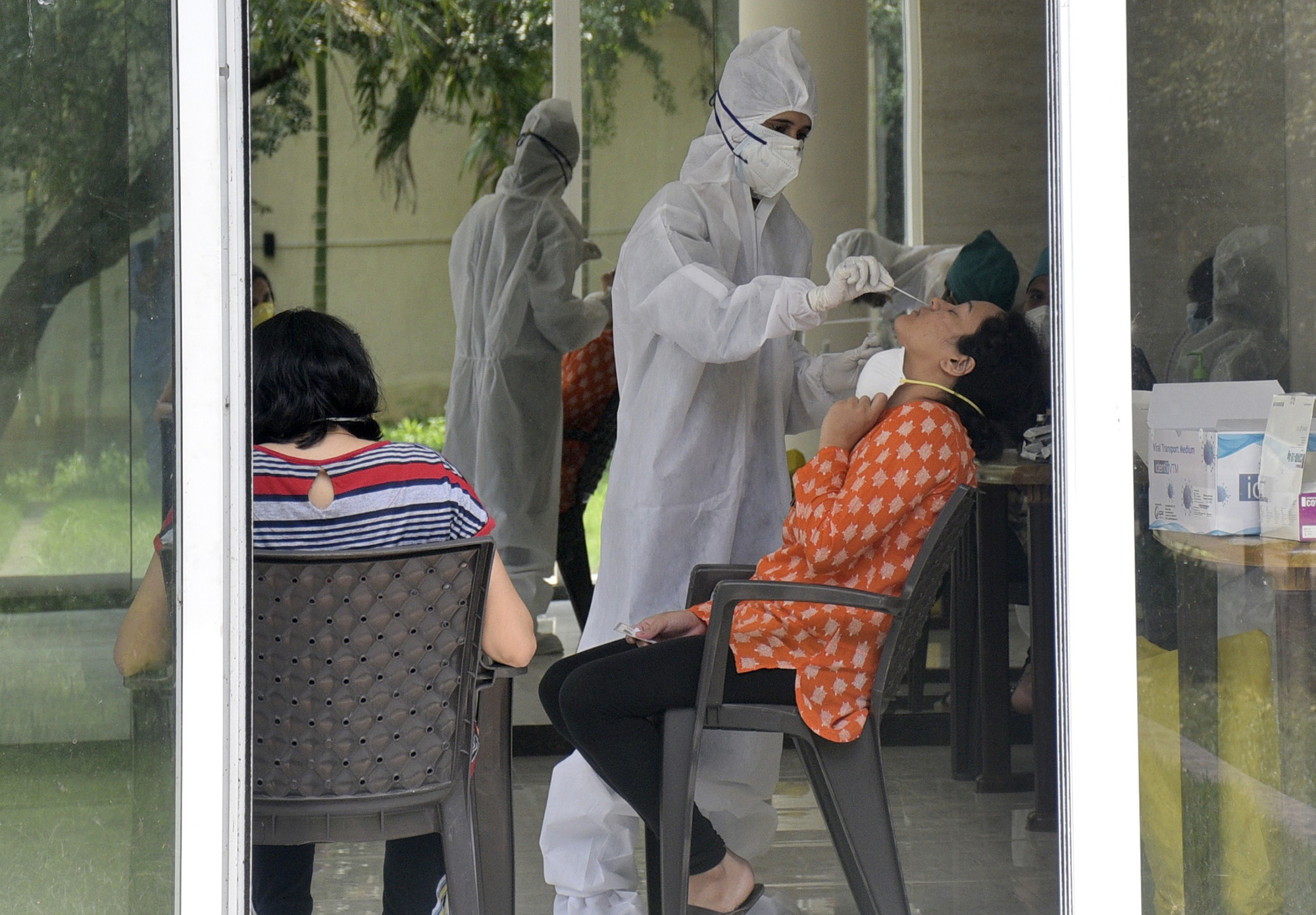 Health care workers during a covid-19 screening and swab test at on September 10, in Mumbai, India.