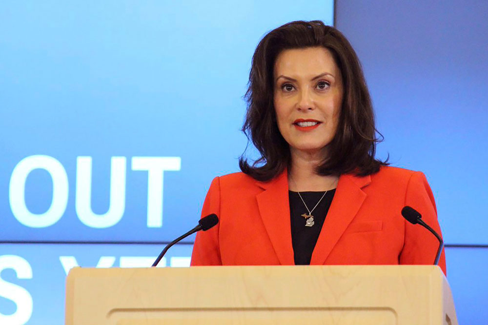 In a photo provided by the governor's office, Michigan Gov. Gretchen Whitmer speaks in Lansing, Michigan, on Monday, May 4.