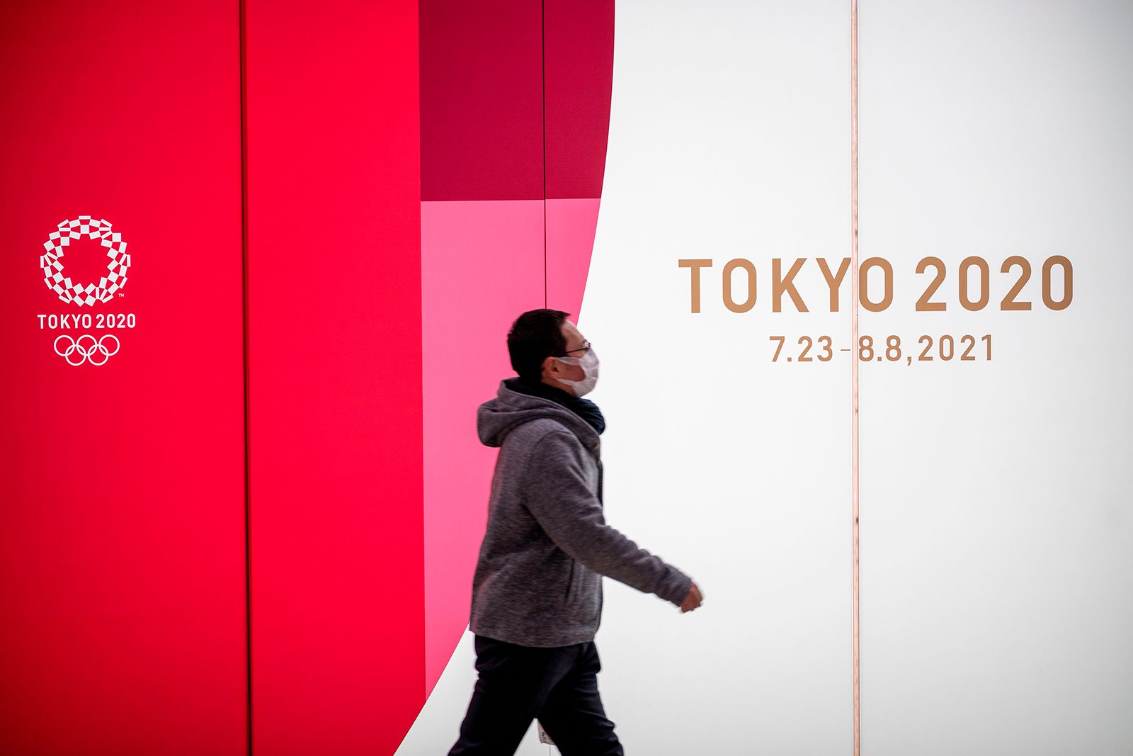A man walks past Tokyo 2020 Olympic and Paralympic Games advertising in Tokyo's Shinjuku district on January 20.