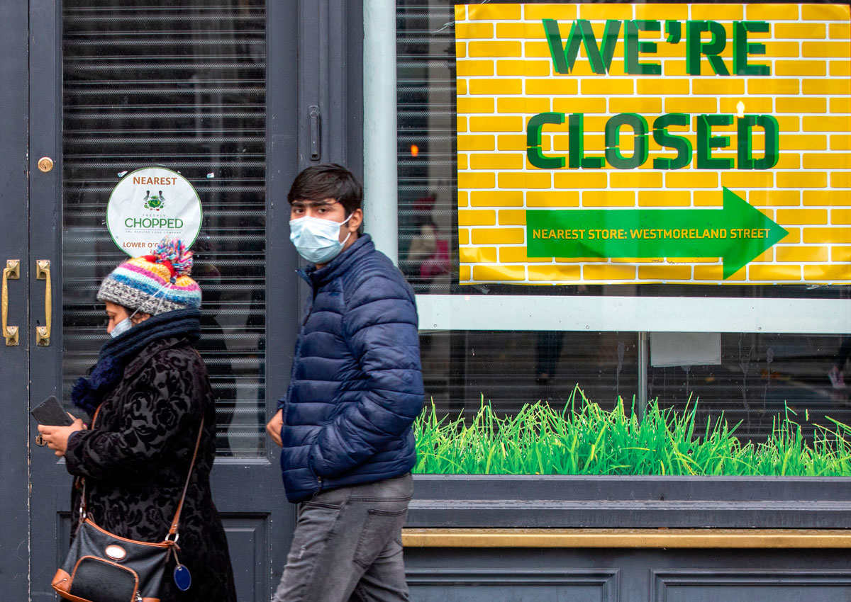 Pedestrians wearing face masks are seen in Dublin, Ireland on October 19.