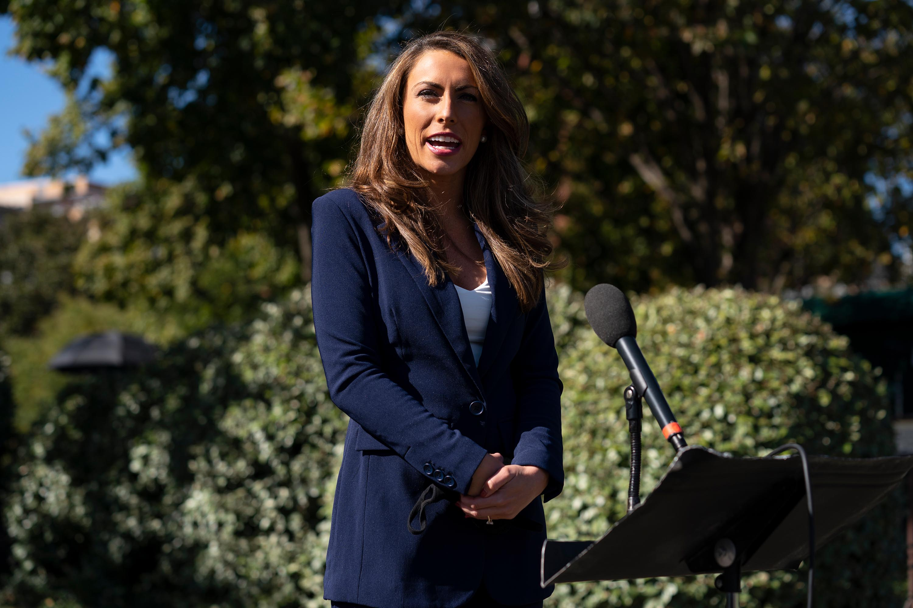 White House director of communications Alyssa Farah talks to reporters outside the White House, Thursday, October 8.