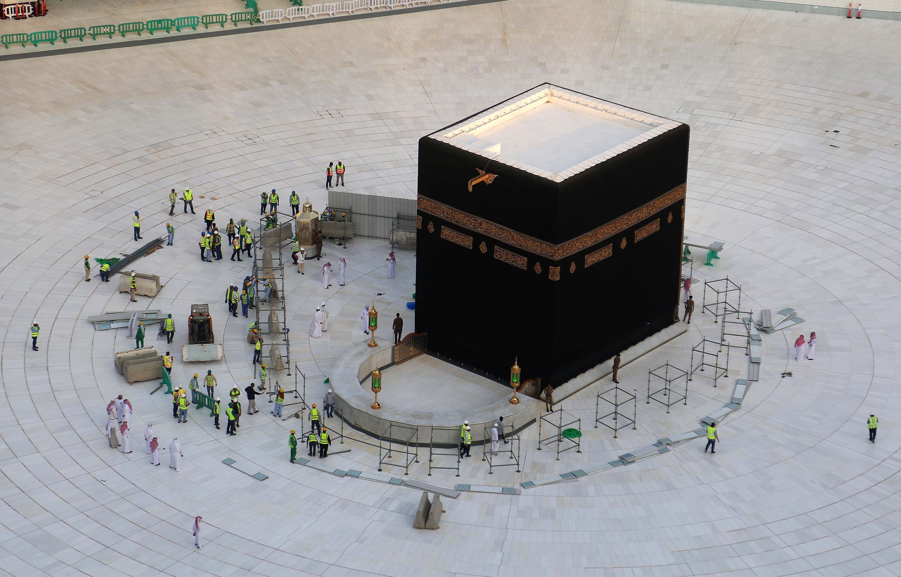 Municipal workers are seen at the Kaaba, inside Mecca's Grand Mosque, on March 5. Saudi Arabia emptied Islam's holiest site for sterilization over coronavirus fears, an unprecedented move after the kingdom suspended the year-round umrah pilgrimage.