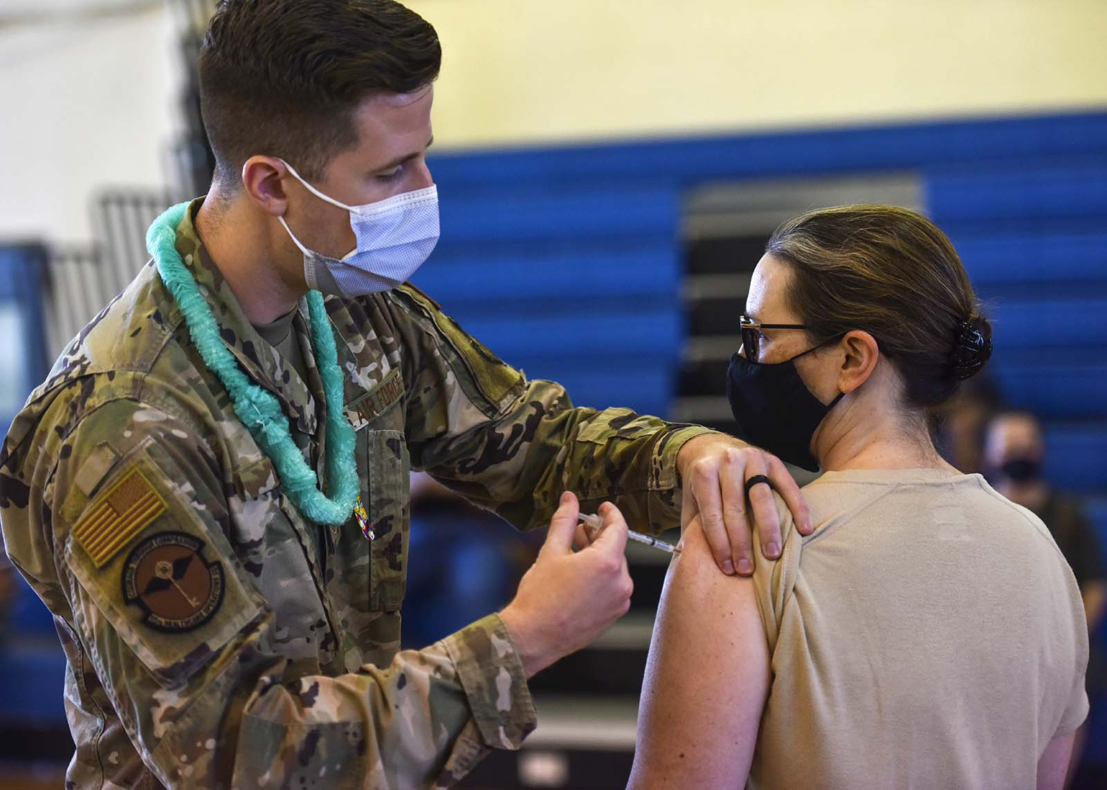 In this Feb. 9, photo provided by the Department of Defense, Hickam 15th Medical Group host the first COVID-19 mass vaccination on Joint Base Pearl Harbor-Hickam.