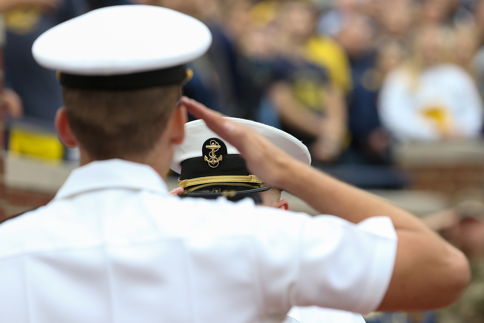 A US Navy officer salutes during the national anthem prior to a college football game at Michigan Stadium in Ann Arbor on September 8, 2018.