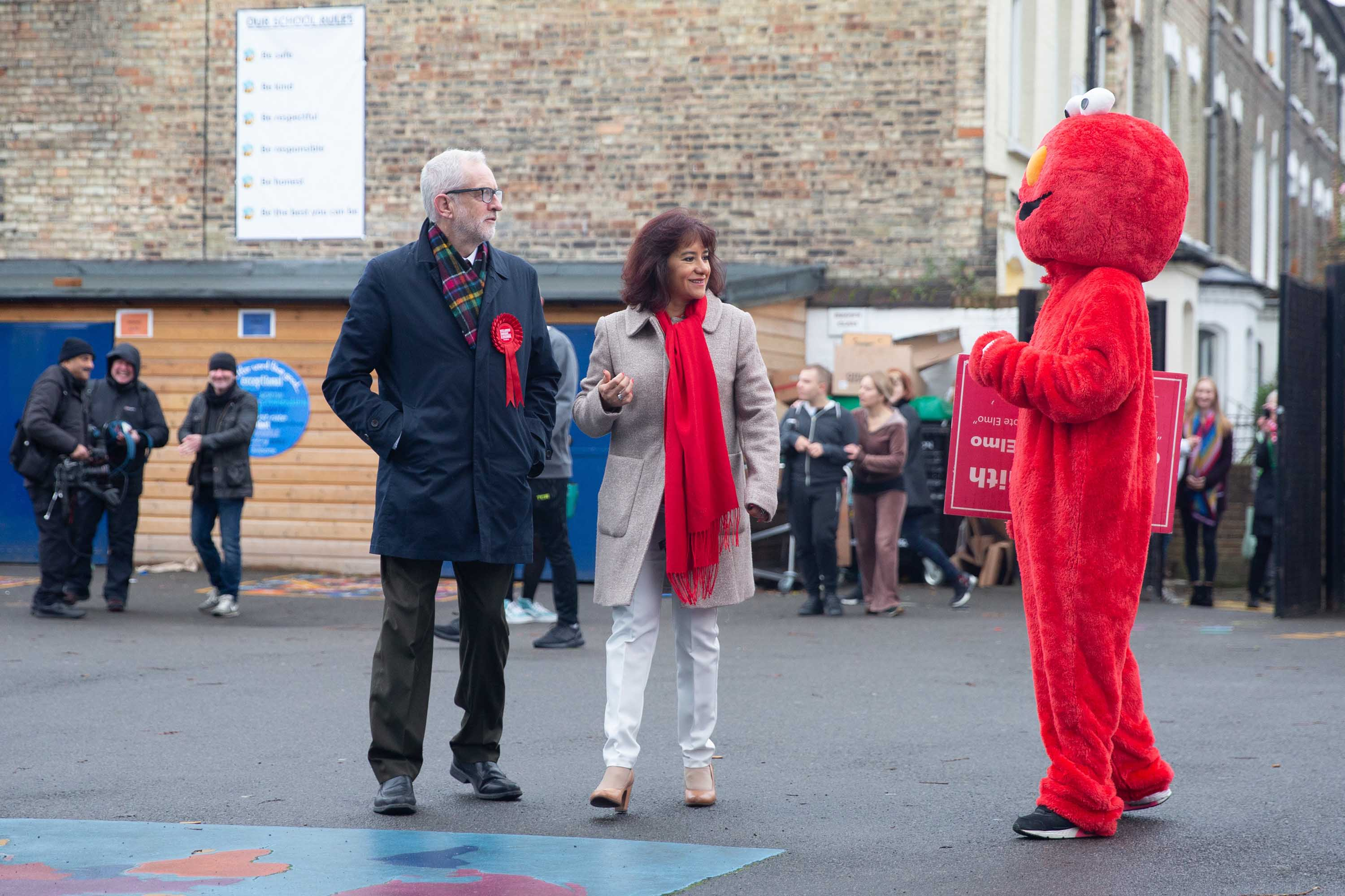 "A person in an ""Elmo"" costume addresses Labour Party Leader Jeremy Corbyn at a polling station in London. Photo: Yunus Dalgic/Anadolu Agency via Getty Images"