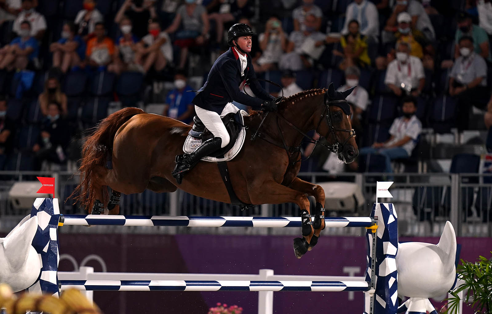 Great Britain's Ben Maher rides Explosion W in the jump-off during the jumping individual final on August 4.