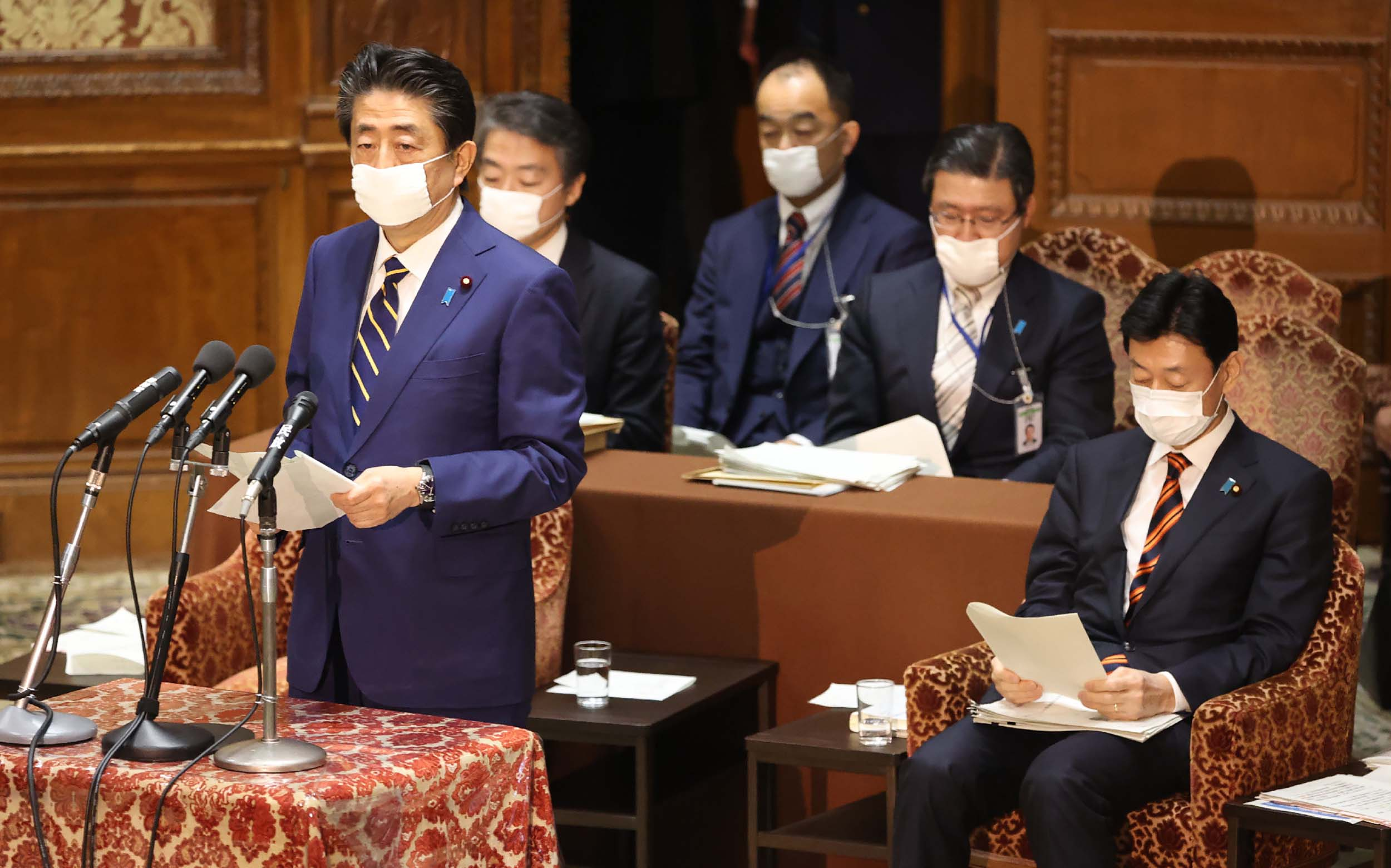 Japan's Prime Minister Shinzo Abe speaks in Tokyo on April 7, before declaring a state of emergency due to the coronavirus outbreak.