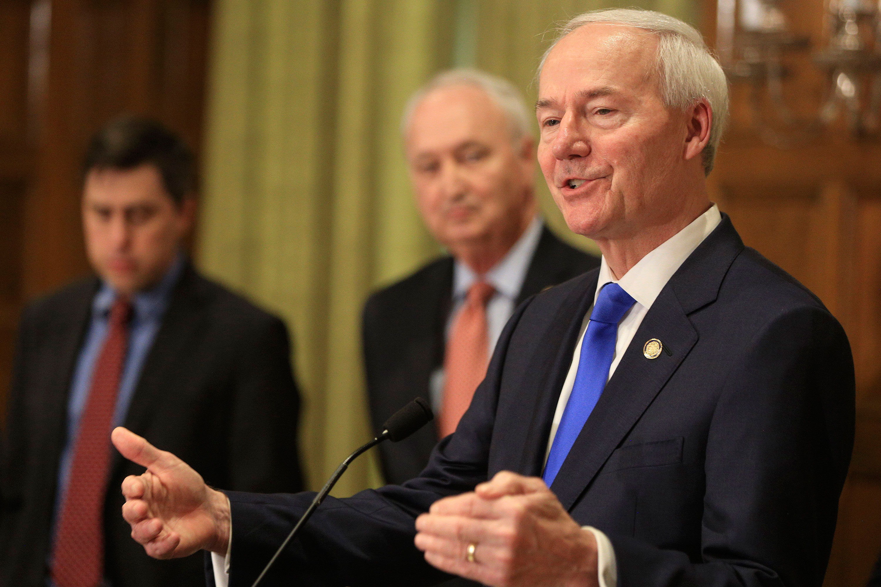 Gov. Asa Hutchinson speaks at a press conference on March 23 in Little Rock, Arkansas.