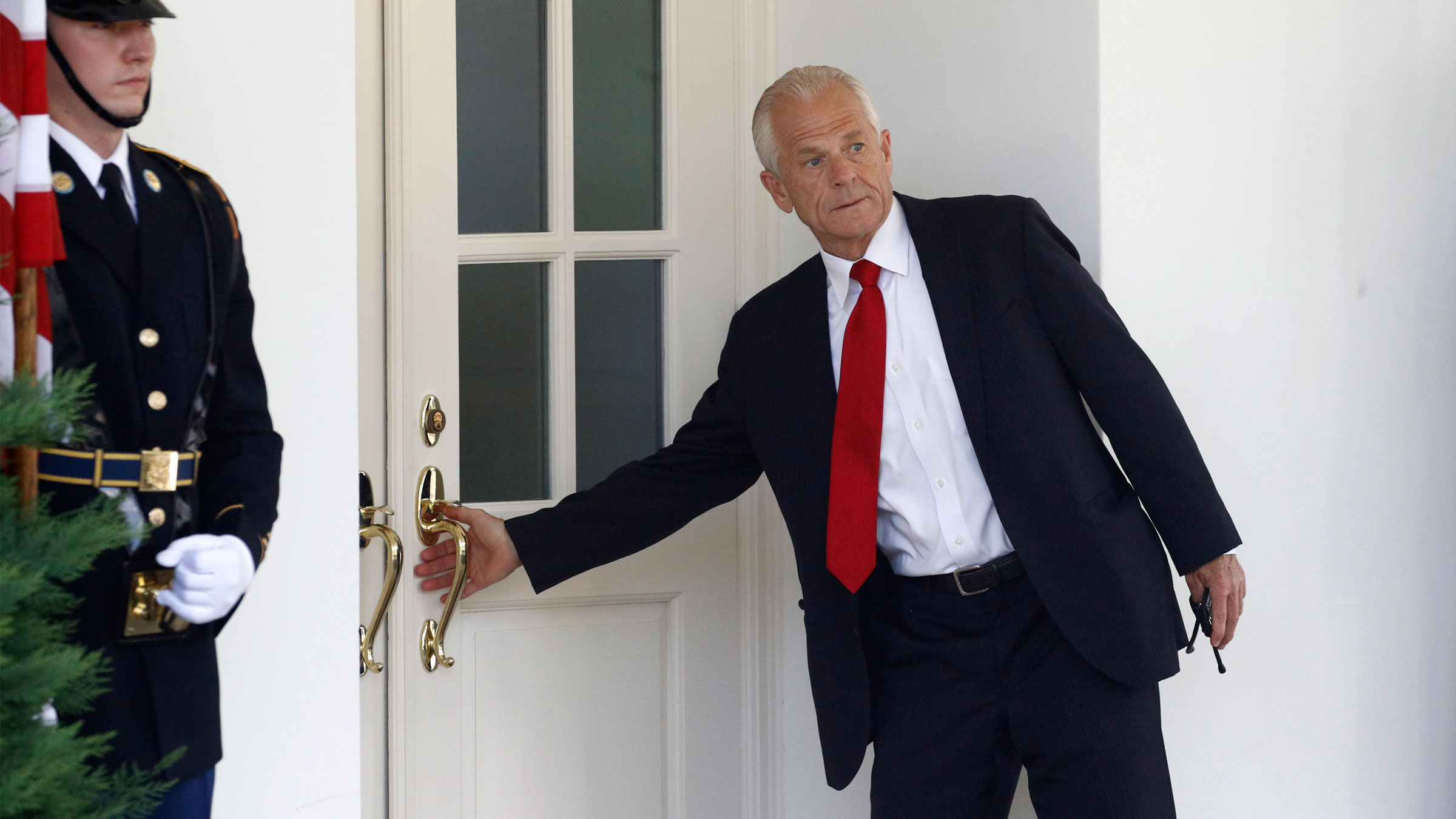White House trade adviser Peter Navarro enters the West Wing of the White House on July 8.
