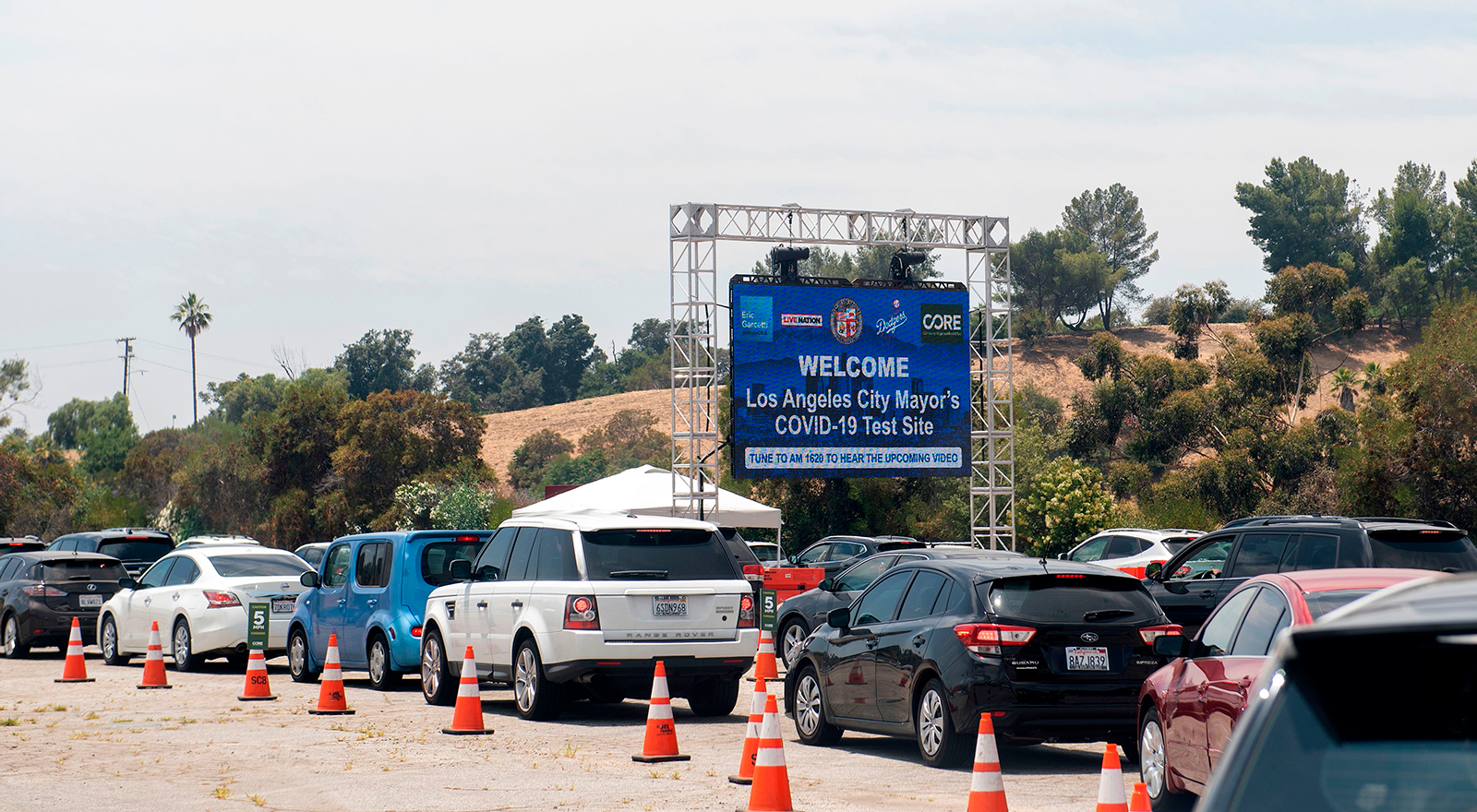 Cars wait in line at a Covid-19 testing center at Dodger Stadium, on June 25, in Los Angeles, California.