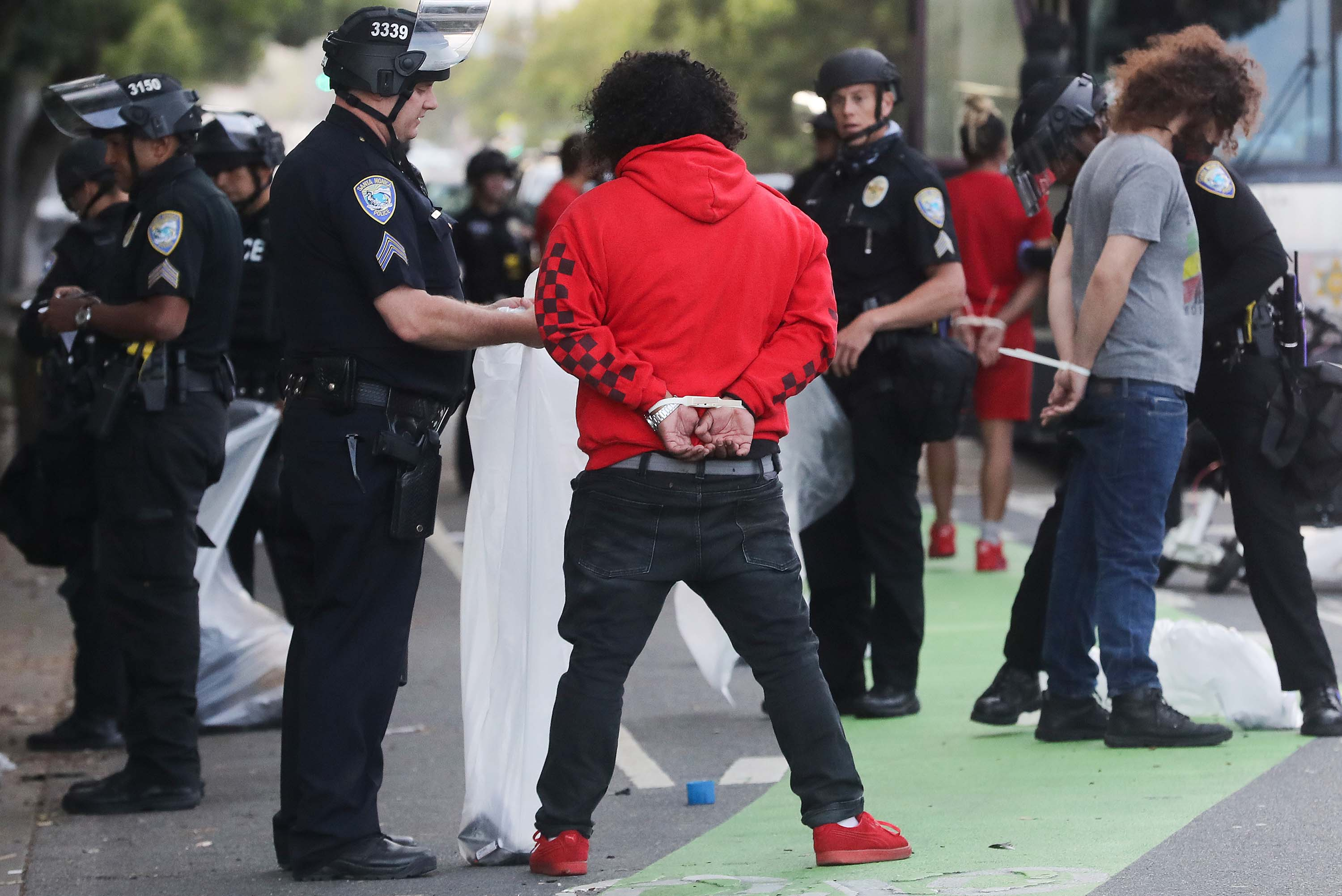 Police arrest people amid demonstrations and some ransacking in Santa Monica, California, in the aftermath of George Floyd's death on May 31.