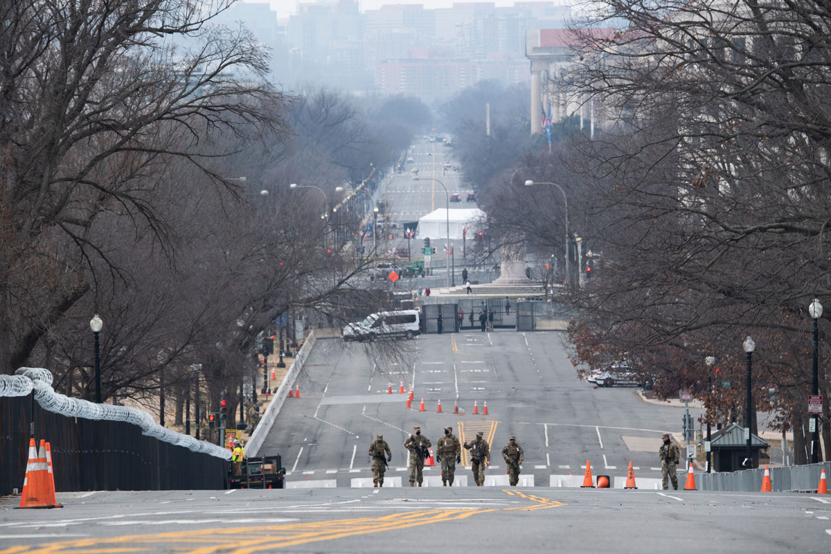 Members of the National Guard walk up an empty Constitution Avenue alongside the US Capitol in Washington, DC on January 15.