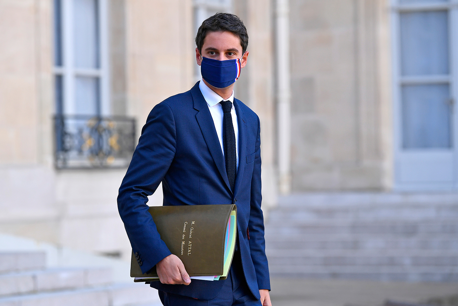 French government spokesman Gabriel Attal leaves the Élysée Palace after a cabinet meeting in November 2020.