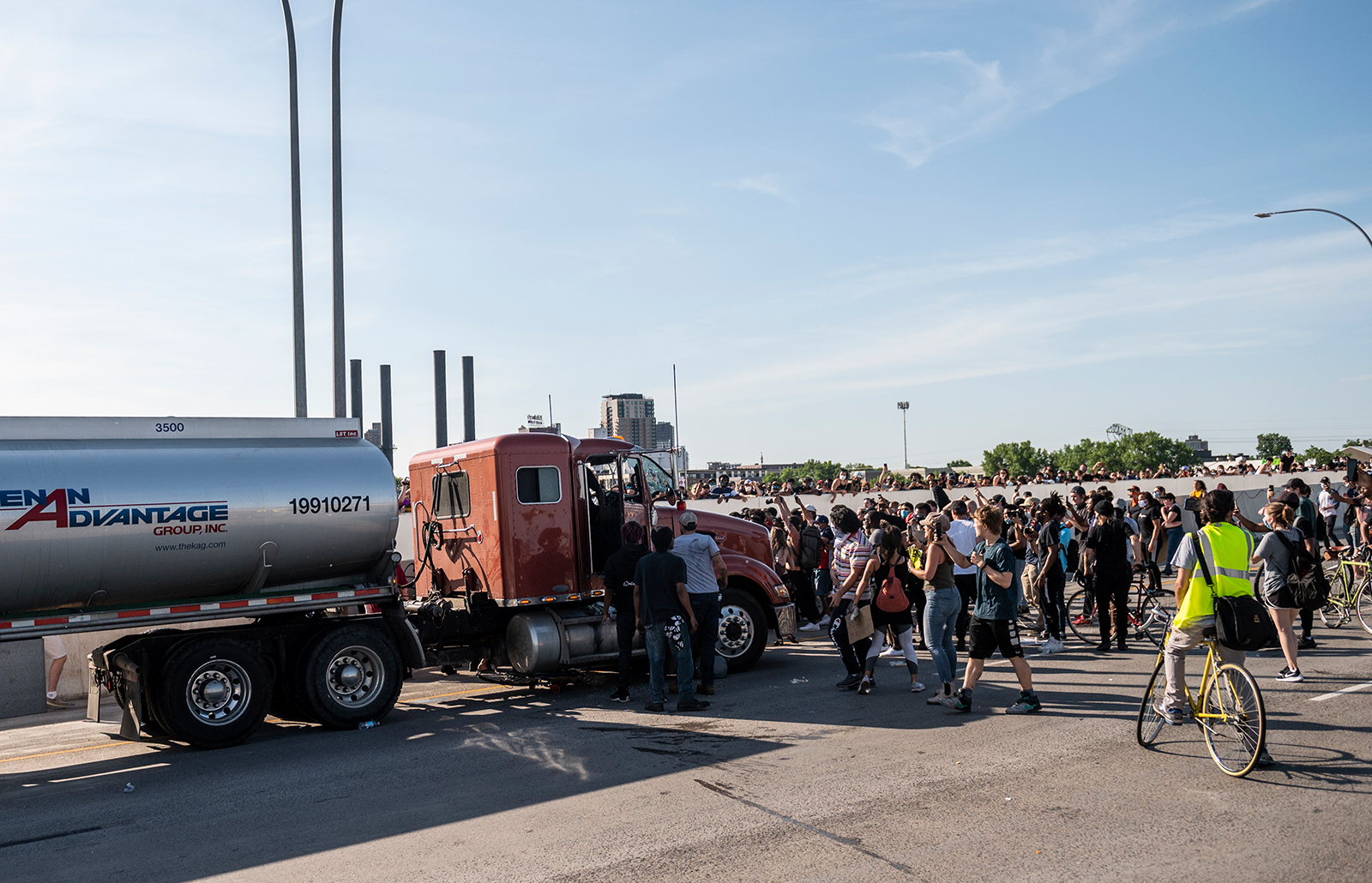 People react after a tanker truck drove into a crowd peacefully protesting the death of George Floyd on the I-35W bridge over the Mississippi River on May 31, in Minneapolis, Minnesota.