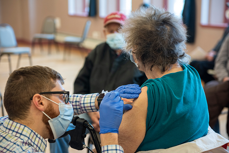 Paramedic Alex Baukus administers a COVID-19 vaccine to a patient at the Park County Health Department COVID-19 vaccination clinic for seniors 80 years and older on January 28, in Livingston, Montana.