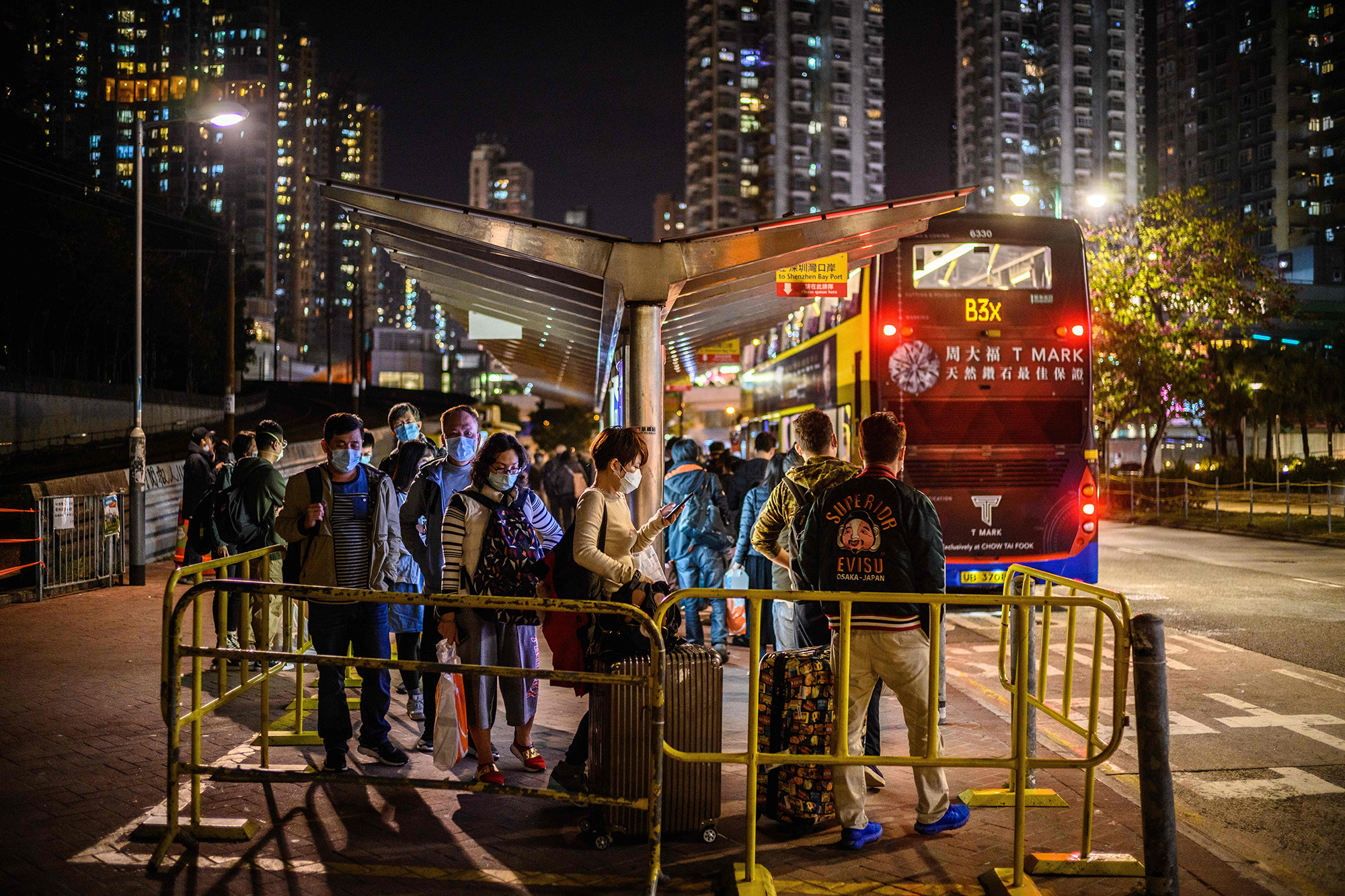 Passengers line up to board a bus from Tuen Mun in Hong Kong to Shenzhen on February 6.