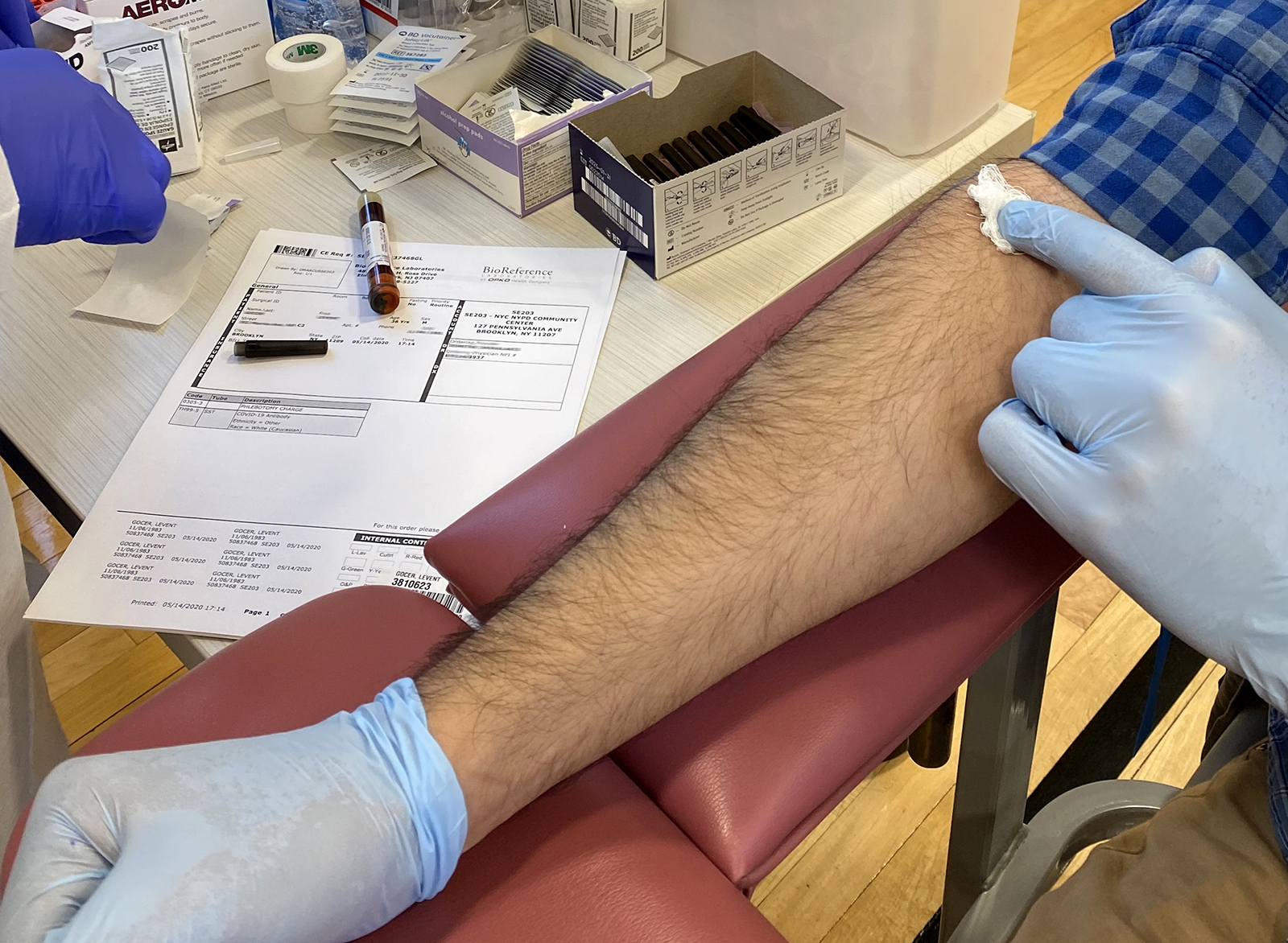 A man gets coronavirus antibody testing at the NYPD Community Center in Brooklyn, New York, on Friday, May 15.