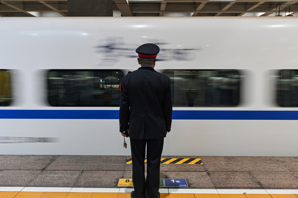 A controller stands by as one of the first trains to leave the city after an outbound travel ban was lifted departs Hankou Railway Station in Wuhan, in China's central Hubei province, early on April 8.