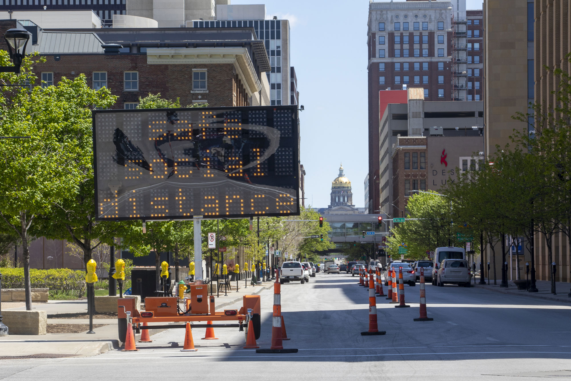 A sign promotes social distancing in downtown Des Moines, Iowa, on May 8.