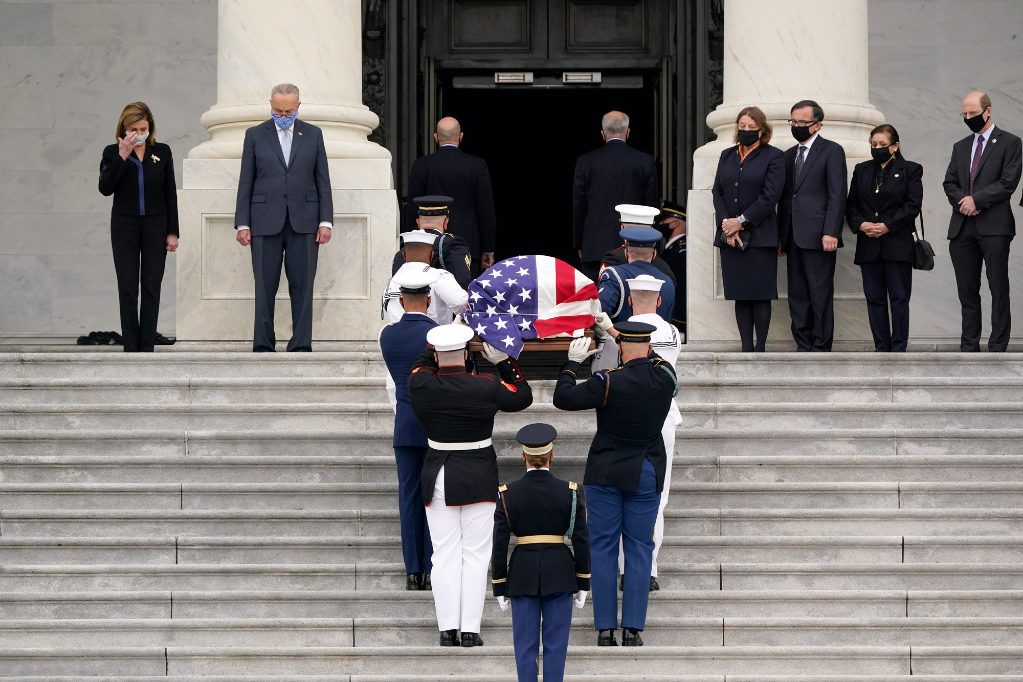 The flag-draped casket of Justice Ruth Bader Ginsburg is carried by a joint services military honor guard to lie in state at the U.S. Capitol on September 25 in Washington, DC.