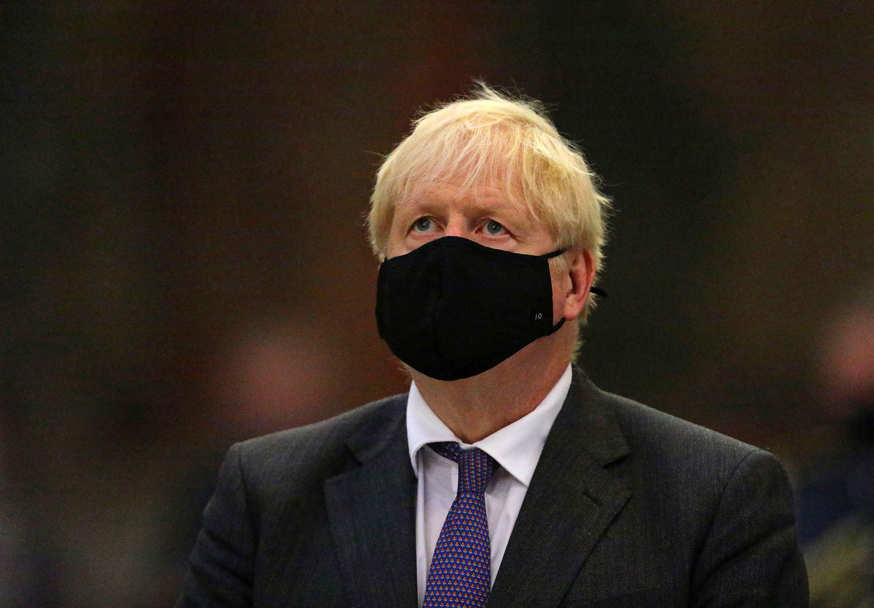 British Prime Minister Boris Johnson attends a service in London on September 20.