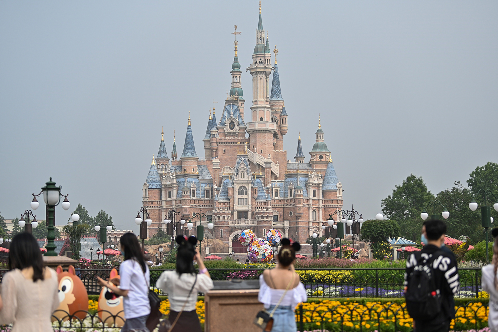 People visit the Disneyland amusement park in Shanghai, China, on May 11, 2020.