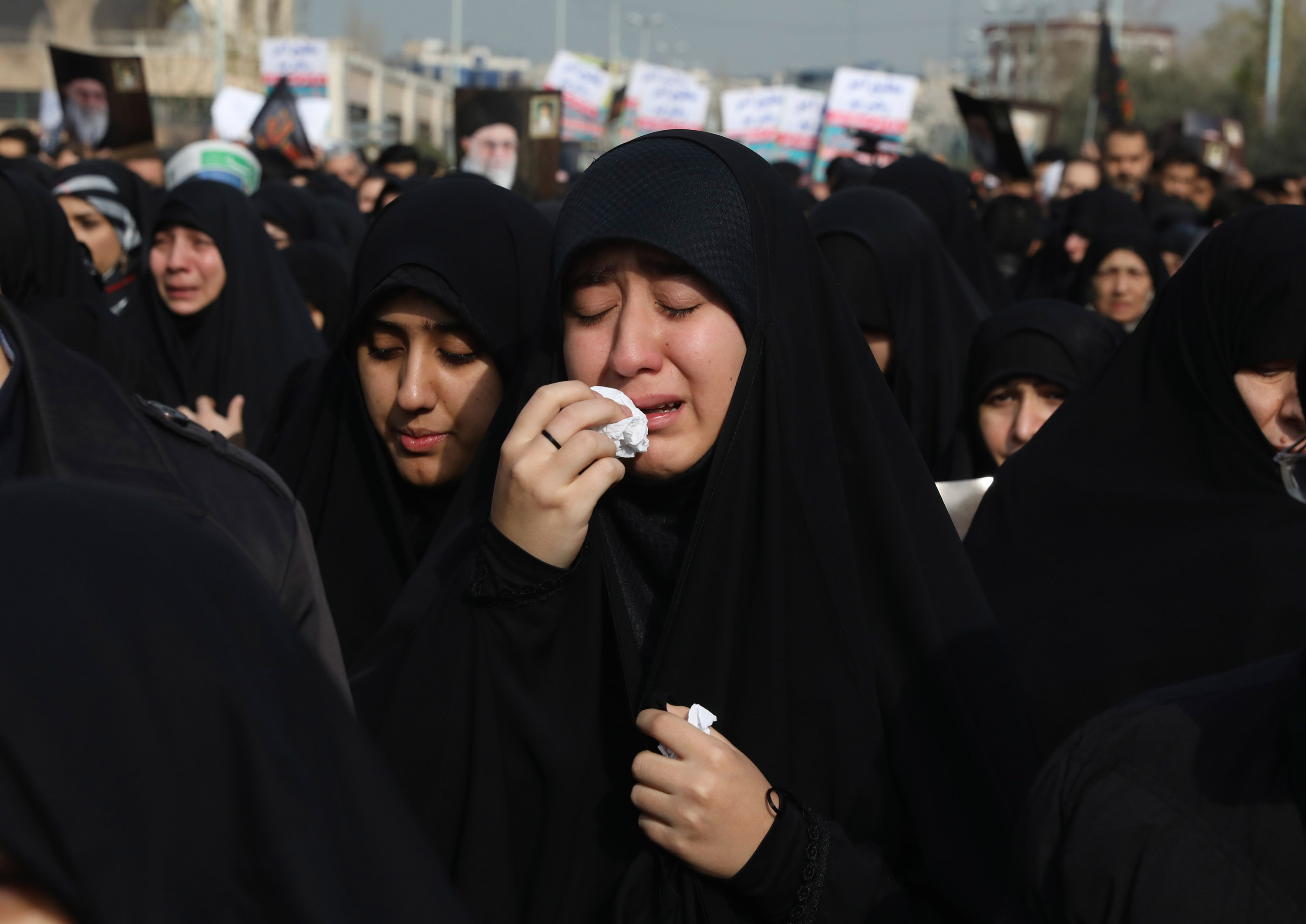 A women reacts during a demonstration over the death of General Qassem Soleimani. Credit: Vahid Salemi/AP