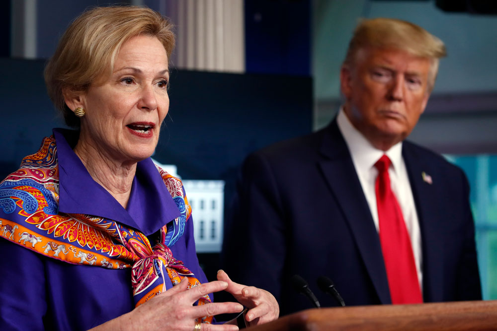 President Donald Trump listens as Dr. Deborah Birx, White House coronavirus response coordinator, speaks about the coronavirus in the James Brady Press Briefing Room of the White House on Wednesday, April 8, in Washington.