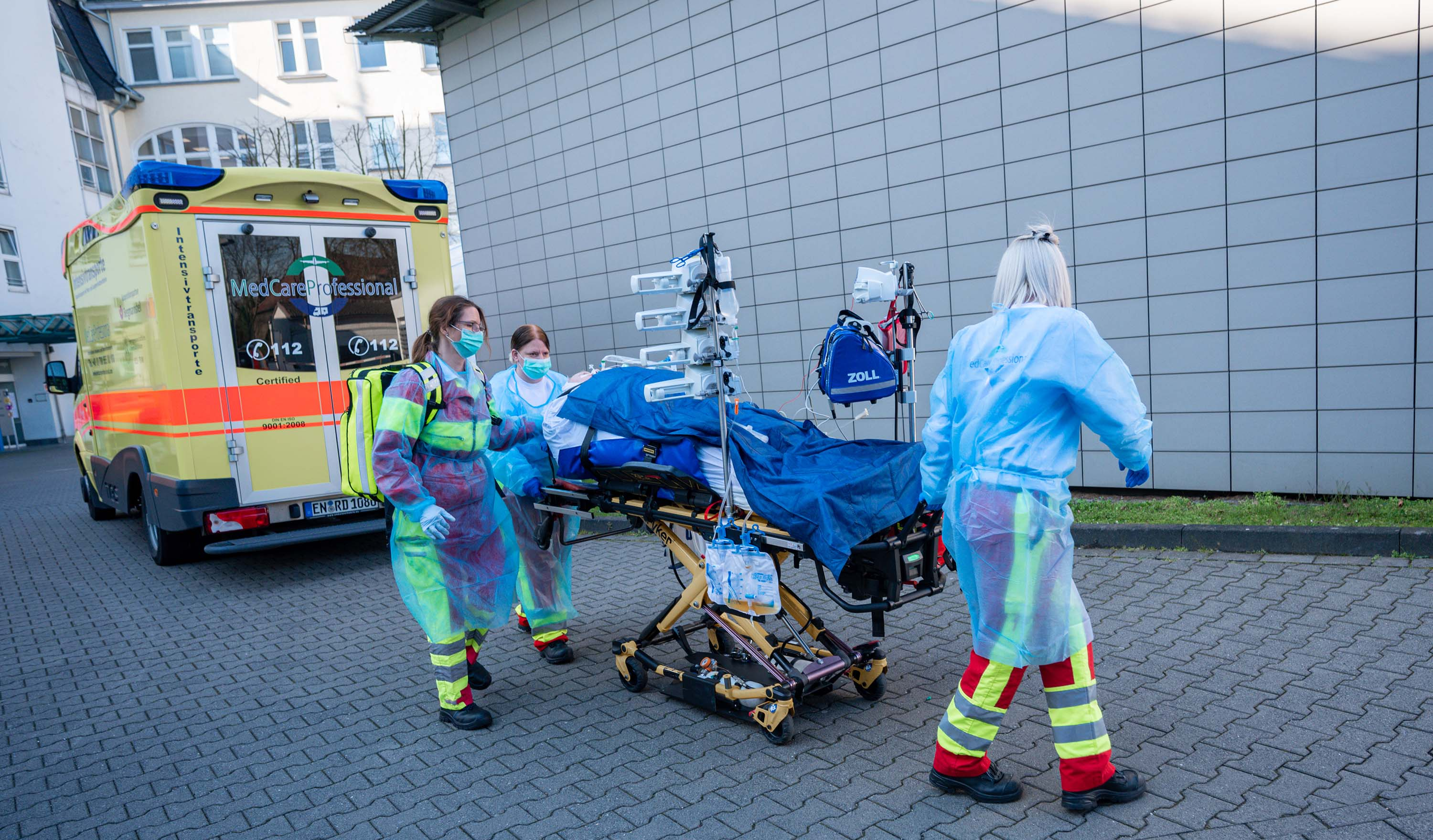 Medical staff transport a patient to the emergency room at the St. Josef Hospital in Bochum, Germany, on April 1.