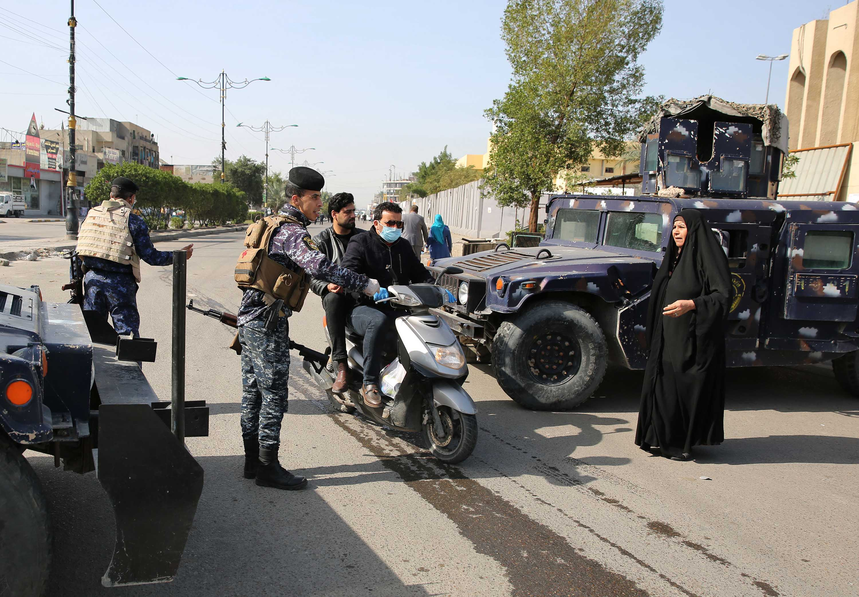 Iraqi police work at a checkpoint in Baghdad, Iraq, on March 24.
