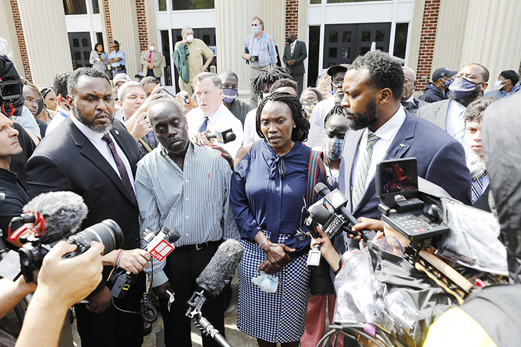 Ahmaud Arbery's parents Marcus Arbery Sr., left,  and Wanda Cooper speak outside  the Glynn County Courthouse in Brunswick, Georgia, on Thursday, June 4, after a court hearing for the three white men accused in the shooting death of unarmed black jogger Ahmaud Arbery.