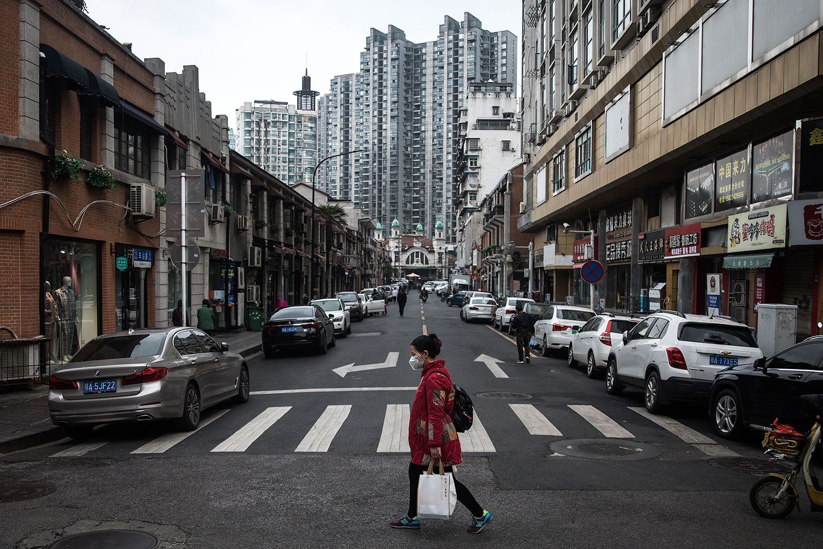 A woman walks in Wuhan, Hubei province, China, on April 11.