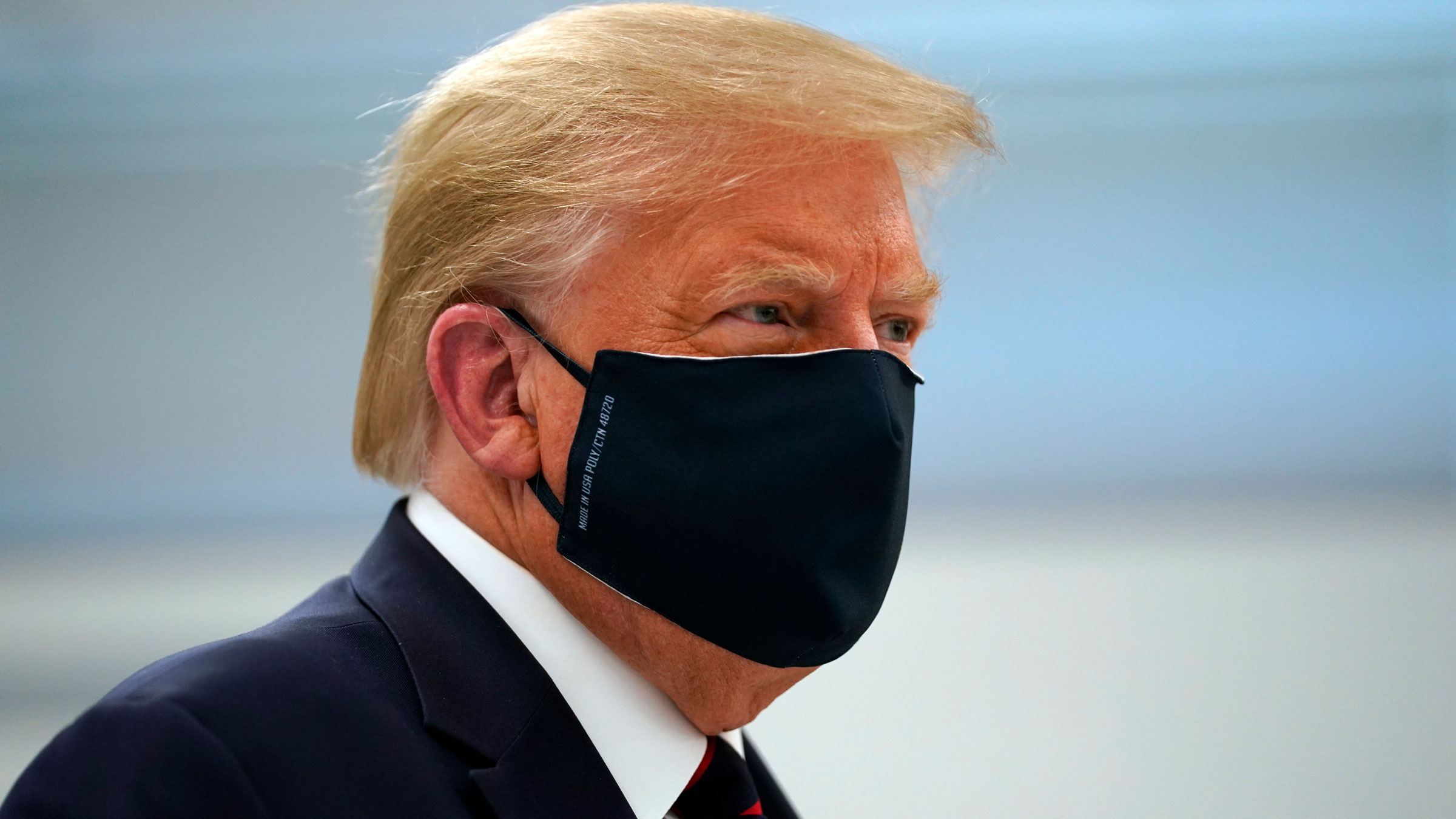 President Donald Trump wears a face mask Monday as he tours the Bioprocess Innovation Center in Morrisville, North Carolina.