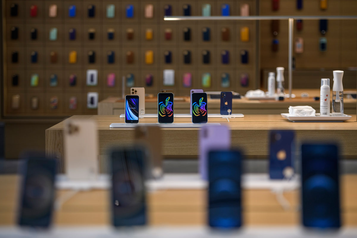 Various iPhone models sit on display at the official opening of the new Apple Store Via Del Corso, in Rome, Italy on May 27.