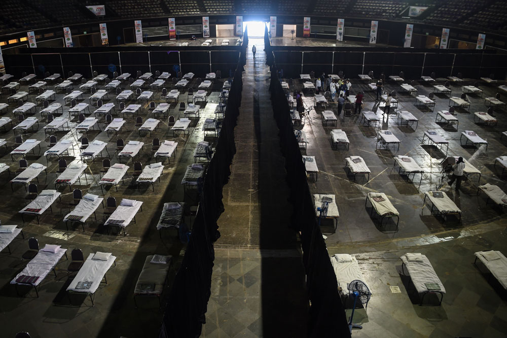 Bombay Municipal Corporation workers prepare an isolation centre at the NSCI dome during a government-imposed nationwide lockdown in Mumbai on April 9.